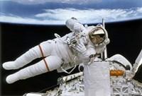 Astronaut Participates in Extravehicular Activity Fine Art Print