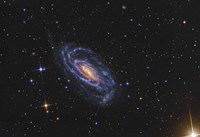 NGC 5033, a spiral galaxy situated in the Constellation of Canes Venatici Fine Art Print