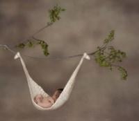 Baby In Knit Hammock Framed Print