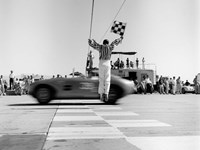 Man Jumping Waving Checkered Flag Fine Art Print