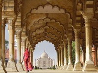 Woman in traditional Sari walking towards Taj Mahal Fine Art Print