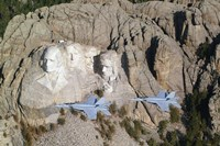 Two F/A-18E Super Hornets conduct a fly by of Mount Rushmore Fine Art Print