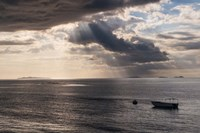 Dramatic light over a little boat, Mamanucas Islands, Fiji, South Pacific Fine Art Print