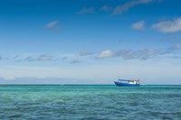 Fishing boat in the turquoise waters of the blue lagoon, Yasawa, Fiji, South Pacific Fine Art Print