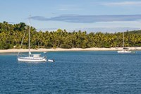 Little sailboat in the blue lagoon, Yasawa, Fiji, South Pacific Fine Art Print
