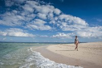 Woman walking on white sand beach of Beachcomber Island, Mamanucas Islands, Fiji Fine Art Print