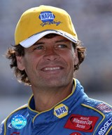 Michael Waltrip in yellow Napa Racing hat
