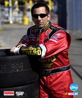 Greg Biffle portrait leaning on a stack of tires
