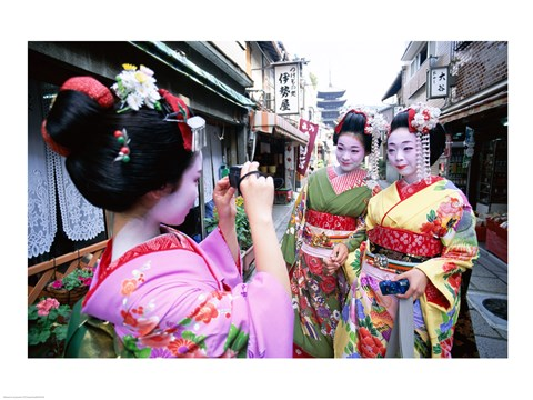 Framed Three geishas, Kyoto, Honshu, Japan (taking pictures) Print