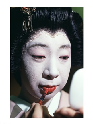 Framed Close-up of a geisha applying lipstick to her lips Print