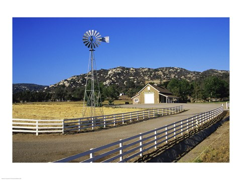 Framed Industrial windmill on a farm, California, USA Print