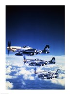 Four fighter planes in flight, P-51 Mustang