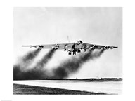 Low angle view of a fighter plane taking off, B-52 Stratofortress  Fine Art Print