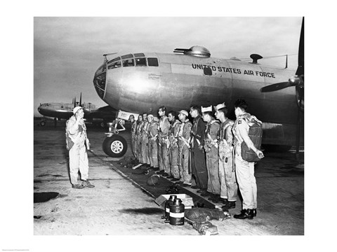 Framed Group of army soldiers standing in a row near a fighter plane, B-29 Superfortress Print
