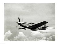 Low angle view of a military airplane in flight, F-51 Mustang Art