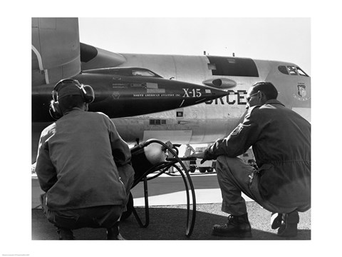Framed Rear view of two men crouching near fighter planes, X-15 Rocket Research Airplane, B-52 Mothership Print