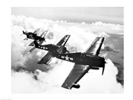 High angle view of four fighter planes flying in formation, F6F Hellcat