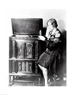 Young woman sitting beside an RCA Radio-Phonograph and Home Recorder