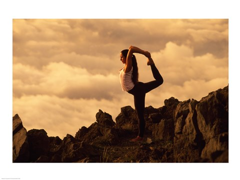 Framed Silhouette of a young woman Practicing Yoga on Mountainside Print