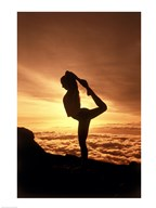 Silhouette of a young woman practicing yoga, Haleakala National Park, Maui, Hawaii, USA