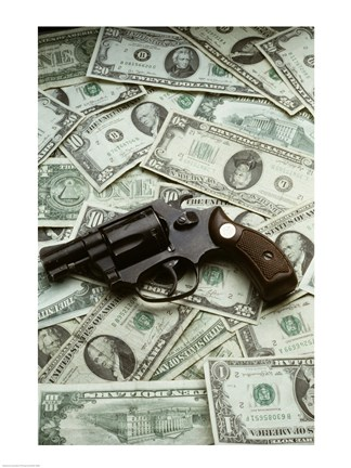 Framed Close-up of a handgun with paper currency Print