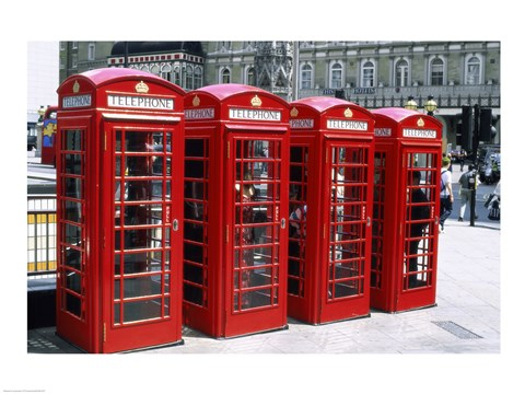 Framed Telephone booths in a row, London, England Print