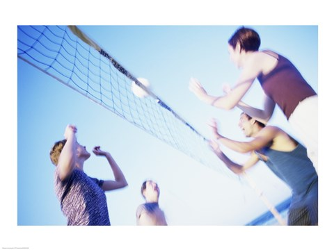 Framed Low angle view of two young couples playing beach volleyball Print