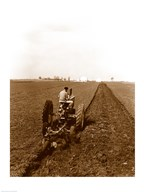 USA, Pennsylvania, Farmer on Tractor Plowing Field