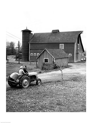 Framed Man with a Boy Riding a Tractor in a Field Print