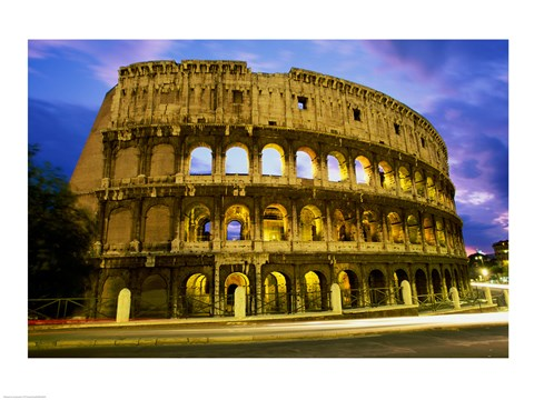 Framed Low angle view of the old ruins of an amphitheater lit up at dusk, Colosseum, Rome, Italy Print