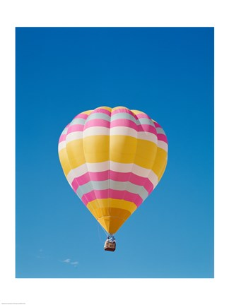 Framed Low angle view of a hot air balloon in the sky, Albuquerque, New Mexico, Yellow & Pink Print