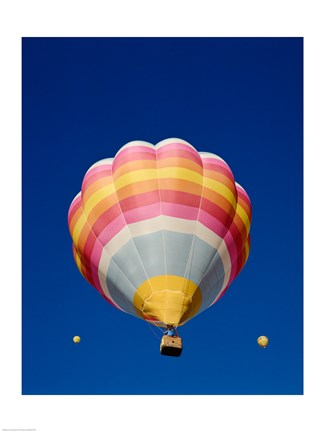 Framed Low Angle Shot of a Rainbow Hot Air Balloon Print