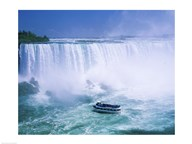 High angle view of a tourboat in front of a waterfall, Niagara Falls, Ontario, Canada Art