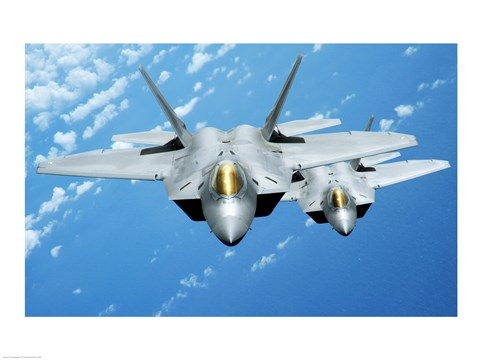 Framed Two F-22 Raptors fly over during a theater security mission, Pacific Ocean Print