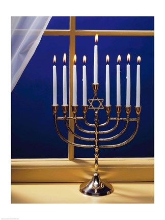 Framed Close-up of burning candles on a menorah at a window Print