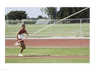 Male athlete pole vaulting