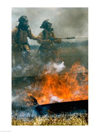 Framed Two firefighters extinguishing a fire Print