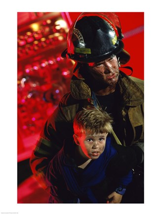 Framed Close-up of a firefighter carrying a boy Print
