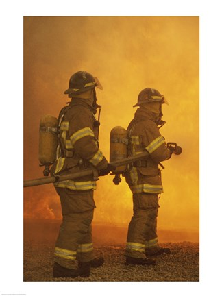 Framed Rear view of two firefighters extinguishing a fire Print