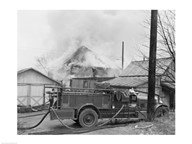 Fire engine next to home in fire  Fine Art Print