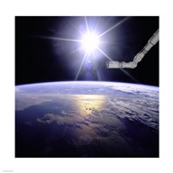 Robot Arm Over Earth with Sunburst