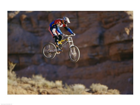 Framed Side profile of a person on a bicycle in mid air Print