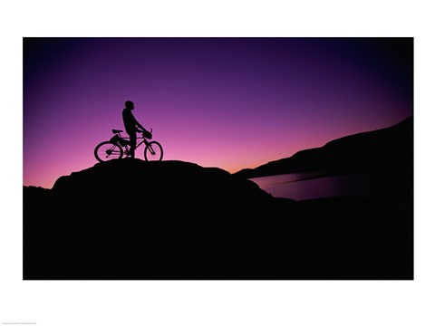 Framed Silhouette of a man standing with his mountain bike, Lake Powell, Utah, USA Print