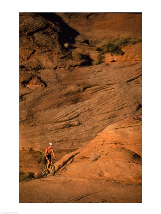 Framed High angle view of a man mountain biking, Moab, Utah, USA Print