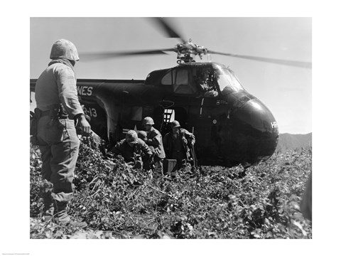 Framed Korea, US Marine Corps, soldiers exiting military helicopter Print