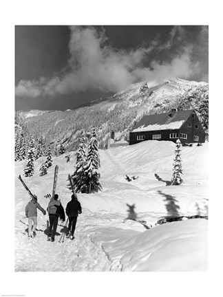 Framed USA, Washington state, three people carrying their skis Print