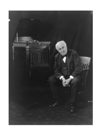 Framed Thomas Edison, seated beside phonograph Print