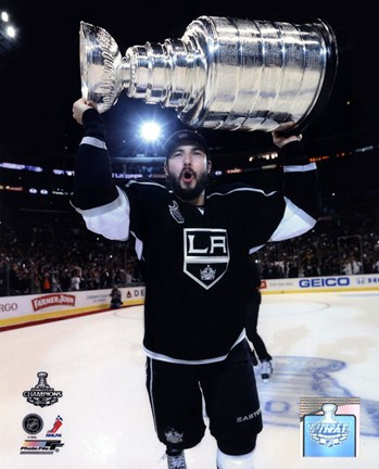 Framed Drew Doughty with the Stanley Cup Trophy after Winning Game 6 of the 2012 Stanley Cup Finals Print