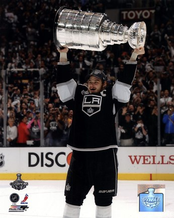 Framed Dustin Brown with the Stanley Cup Trophy after Winning Game 6 of the 2012 Stanley Cup Finals Print