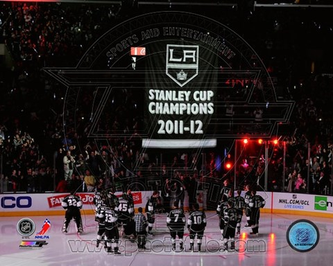 Framed Los Angeles Kings watch as their 2011-12 Championship Banner is raised Print